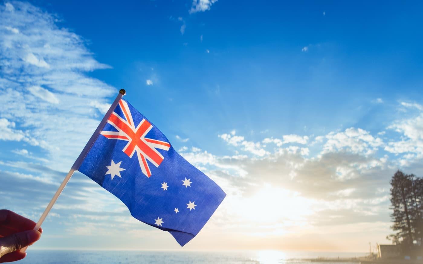 Australian flag held on sea background