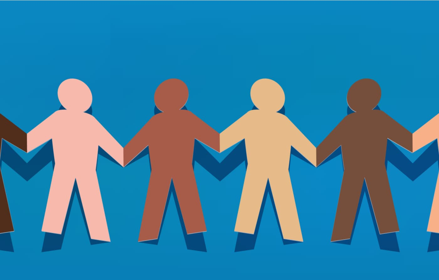 Multi cultures paper people holding hands