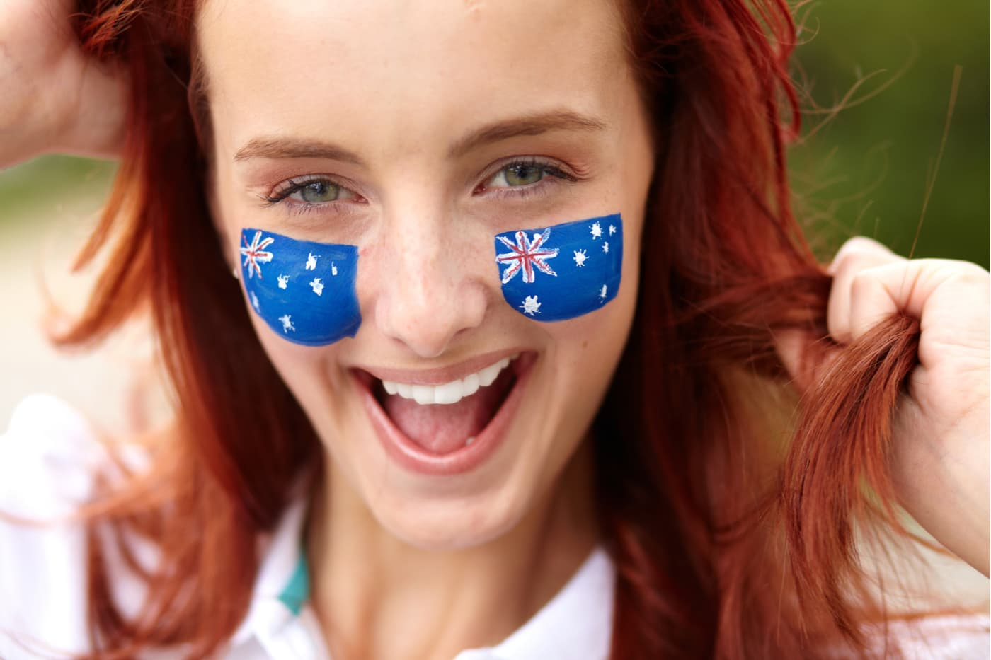 Redhead with face paint of Australian flags