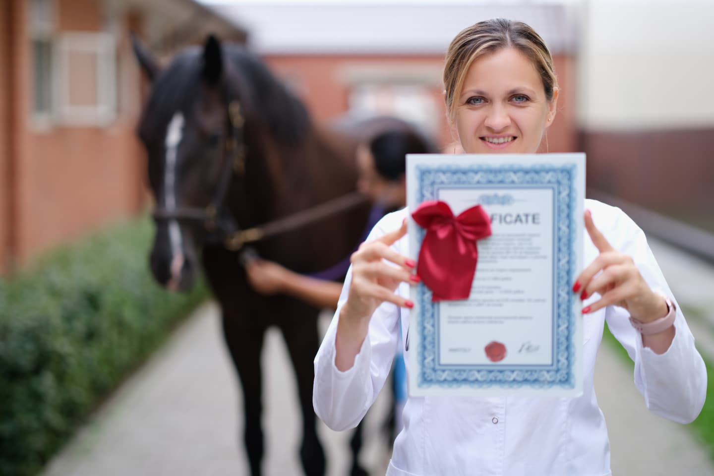 Woman vet holding up her certificate
